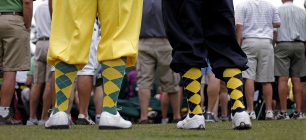 Richard Walker, left, and his son Billy, from Yorkshire, England, wear golf knickers